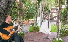 Guitarist plays at elegant wedding ceremony under Paso Robles oak trees